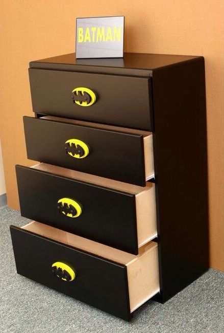 a simple IKEA dresser can be turned into a Batman's with plack paint and Batman knobs