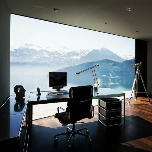 chic manly home office with a glazed wall and adorable mountain views