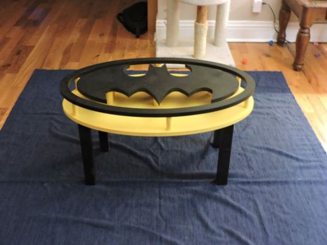 Batman coffee table looks amazing, it's a perfect piece for a man's cave