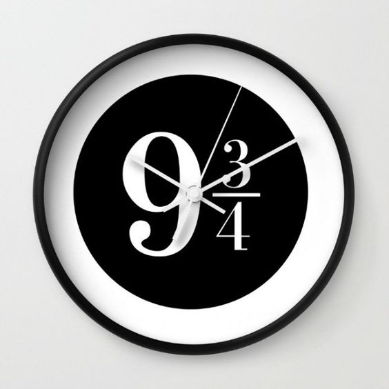 black and white clock with a Hogwarts platform sign looks laconic and modern