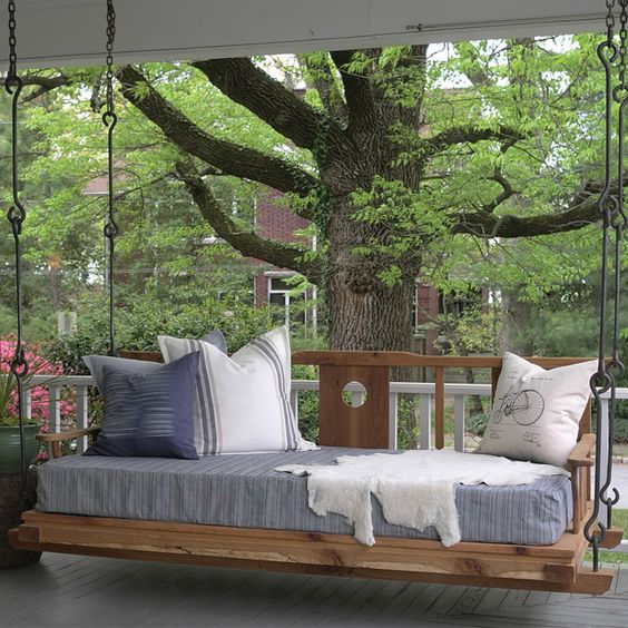 hang a bed on the porch to make it cozier and cuter