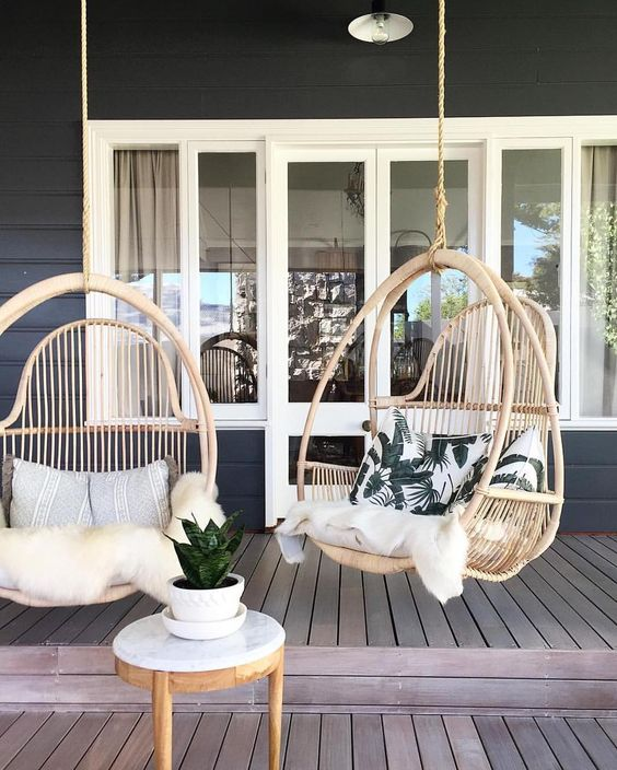 make your deck more welcoming with hanging chairs and cushions