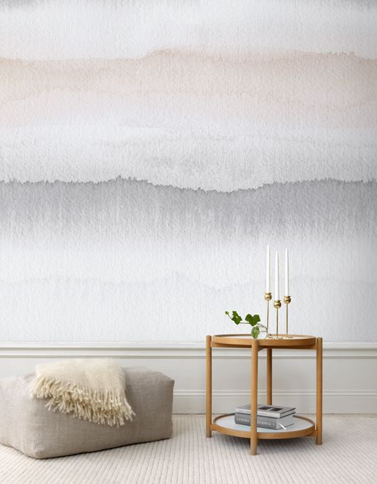 grey and peachy wallpaper sticks to the calming setting