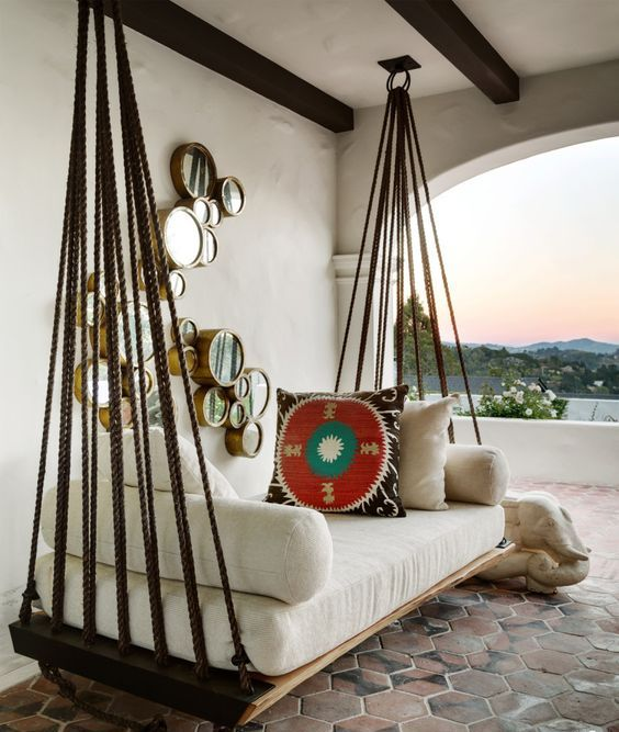 hanging outdoor bed on ropes for a boho-inspired outdoor space