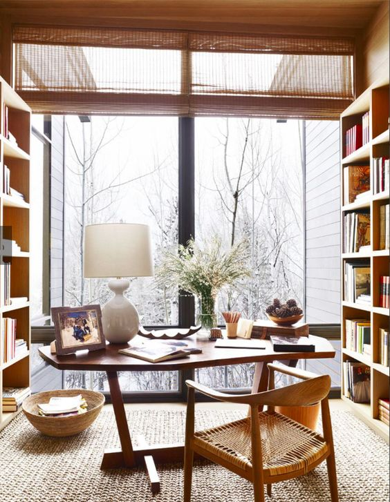 home library and office with a glazed wall and woodland and mountain views