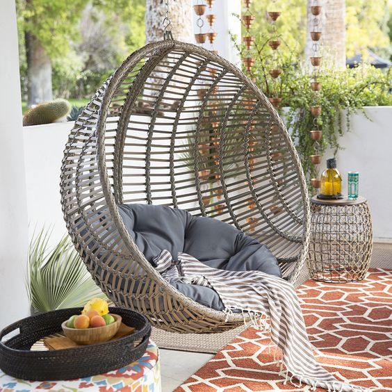 resin wicker hanging chair in a balcony is a perfect choice to chill