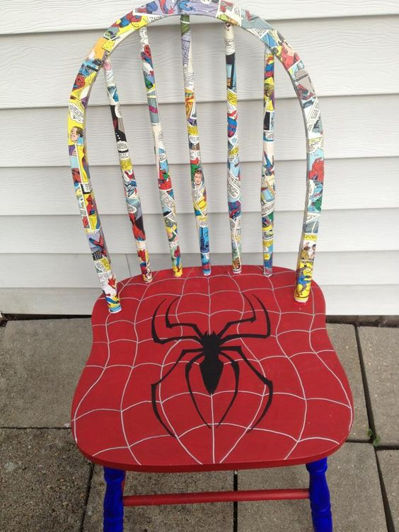 a Spiderman chair with a decoupaged comics chair back