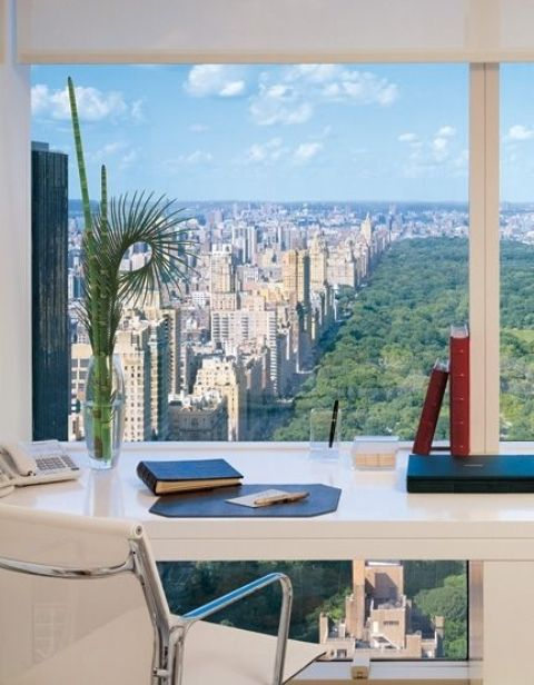 modern home office with a big city and park view to get inspired