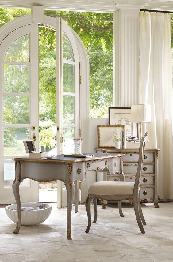 Provence-inspired home office with a glazed wall and a door to enter the garden any time