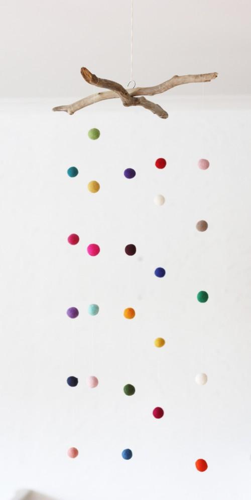 DIY colorful felt balls mobile (via www.shelterness.com)