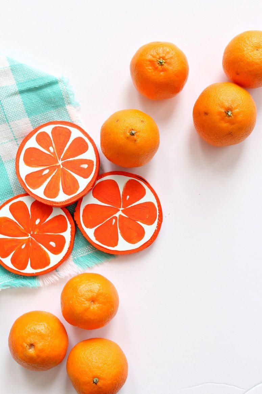 DIY orange slice coasters from birch slices (via www.danslelakehouse.com)
