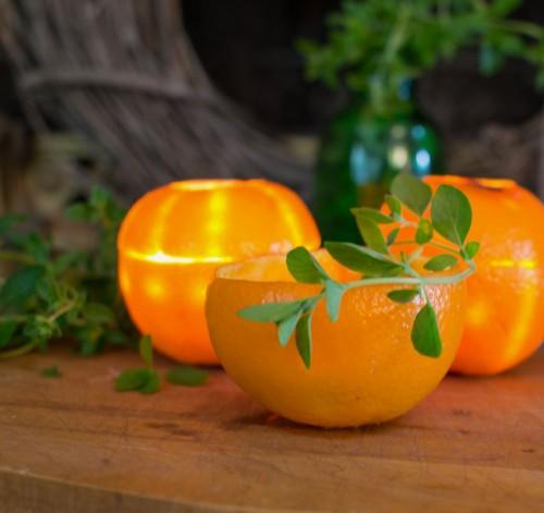 DIY orange rind candles (via www.shelterness.com)