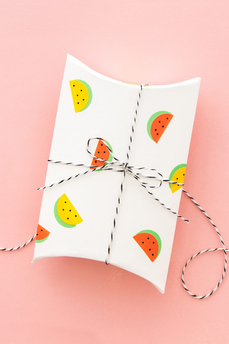 DIY gift wraps with watermelon stickers (via sarahhearts.com)