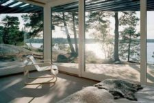 02 a bedroom with glazed walls and amazing forest and lake views looks amazing