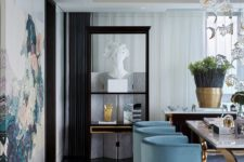 02 light blue velvet chairs with gold legs add chic to this exquisite dining space