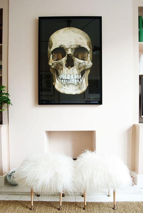 a black and gold skull wall art will make a glam space more dramatic