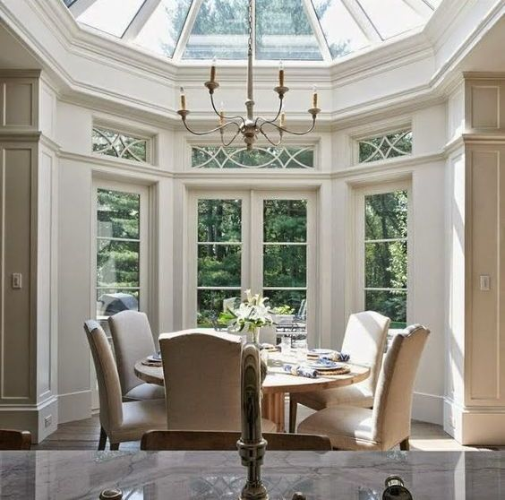 a dining space with a skylight dome is lit from above and looks gorgeous