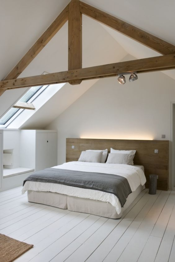 a minimalist bedroom with a small skylight to make it more light filled