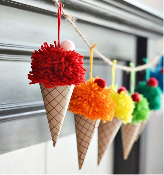 an ice cream cone garland with colorful pompoms and cardboard will cheer the space up