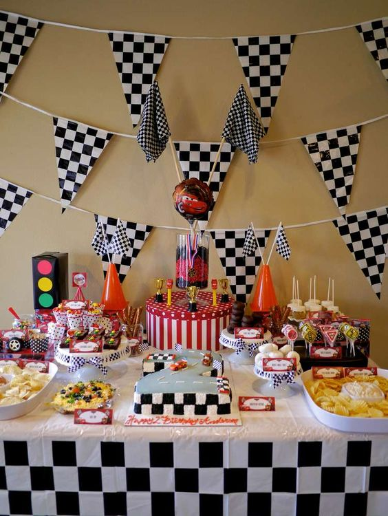 black and white themed dessert table and red touches look wow