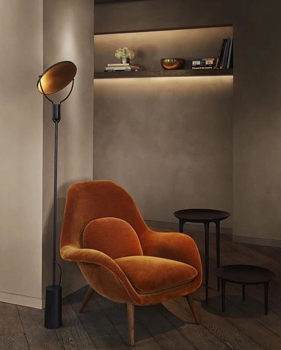 a decadent amber velvet chair is a great idea for a masculine interior to add color
