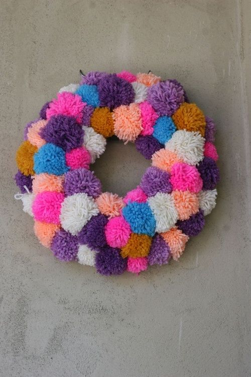 a bold pompom wreath is an easy and long-lasting summer wreath idea