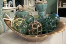05 a bowl with starfish and net floats for a beach feel