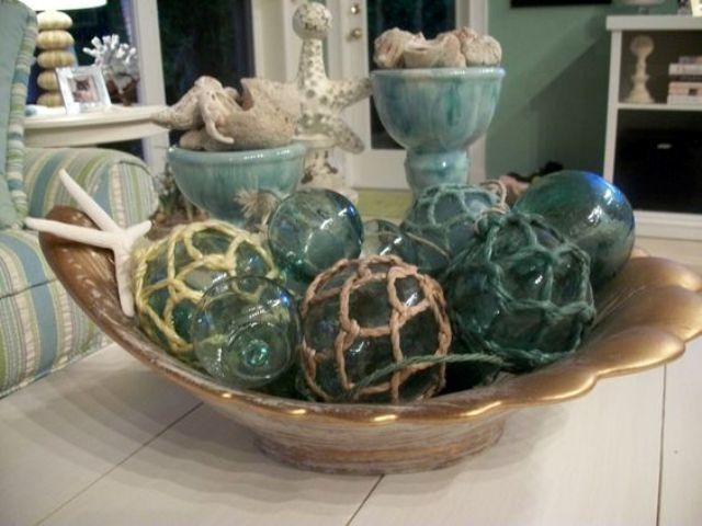 a bowl with starfish and net floats for a beach feel