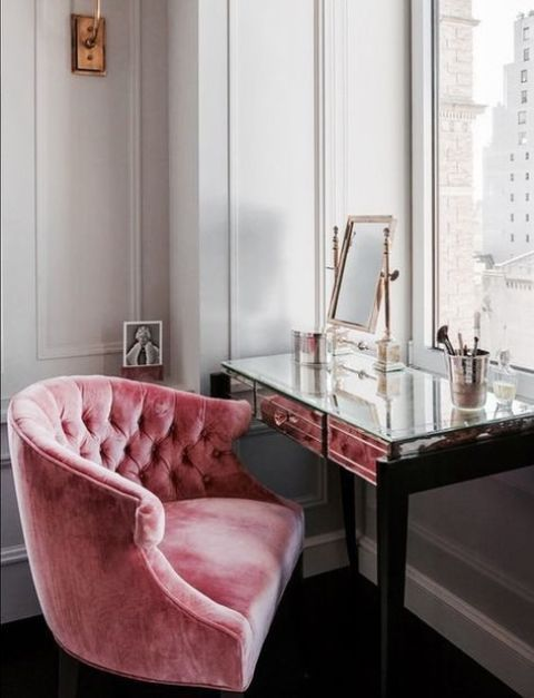 a pink stuffed velvet chair is a great piece for your beauty nook, it will add a glam feel
