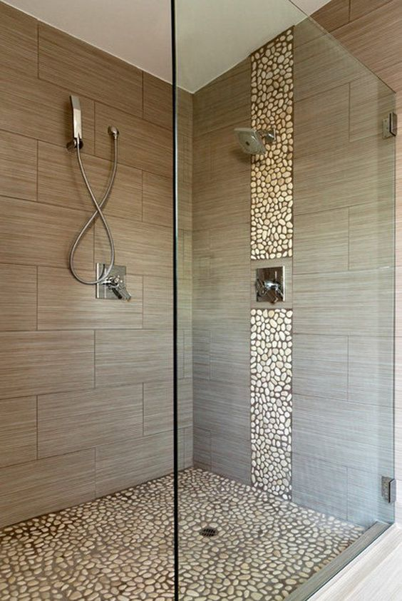 accentuate the shower space with a pebble line and a pebble floor