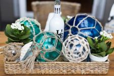 06 a basket with fishing buoys in different colors