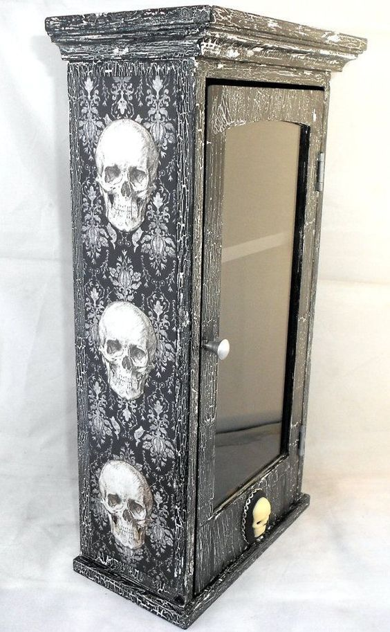 a black and white skull cabinet can be easily DIYed with adhesive wallpaper