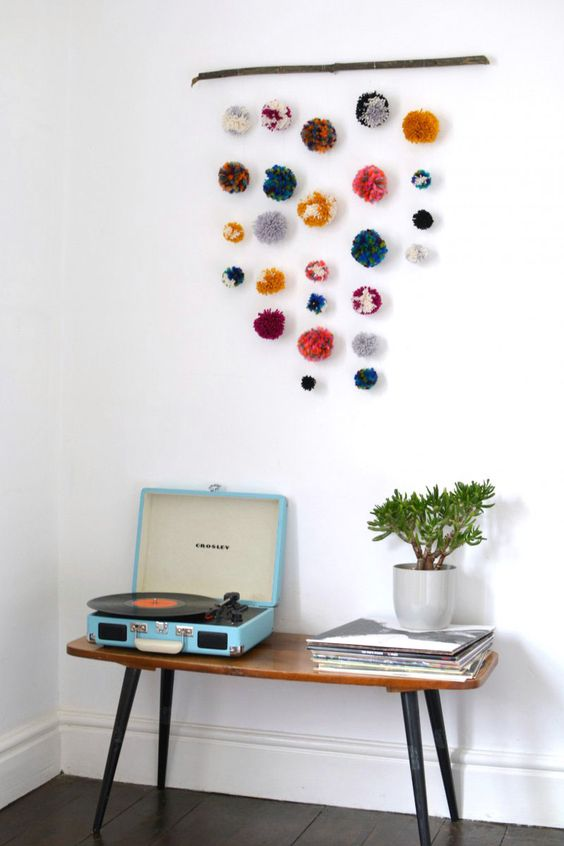 a colorful pompom hanging for boho summer home decor
