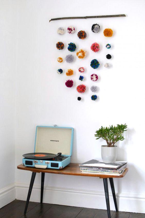 a colorful pompom hanging for boho summer home decor
