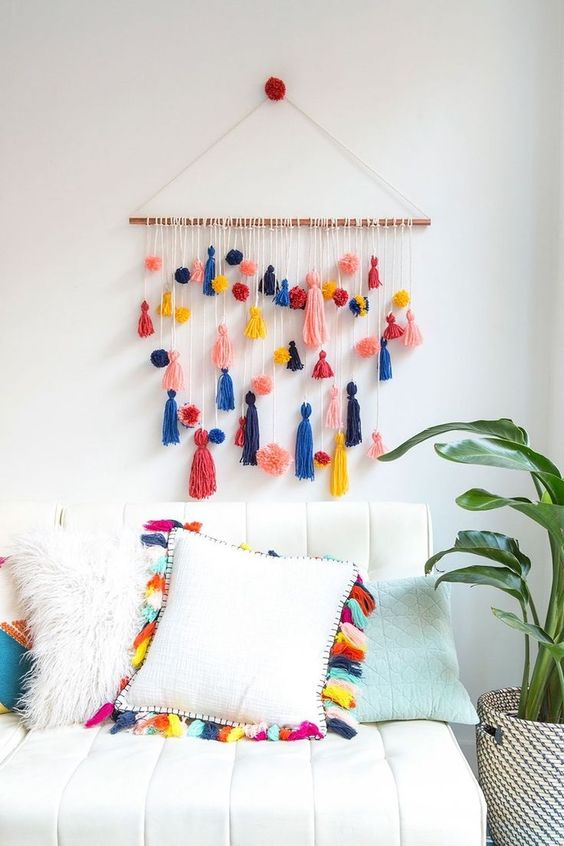 a colorful tassel hanging and a matching pillow will easily make your bedroom summery