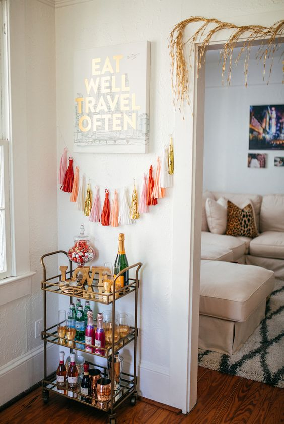 a colorful tassel garland to accentuate your home bar