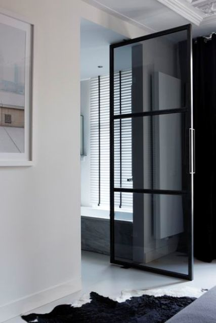 a smoke glass door to the en-suite bathroom looks trendy and chic