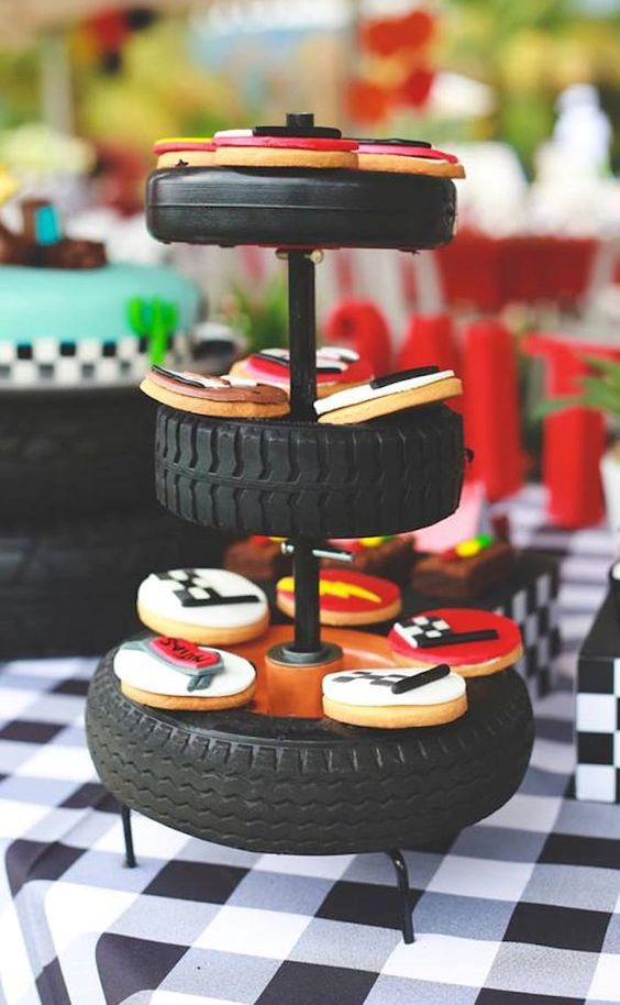 serve glazed themed cookies on a tyre stand