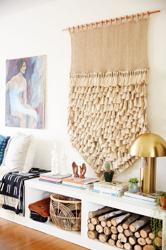 a neutral tassel hanging on the wall to add a cool boho feel to the interior