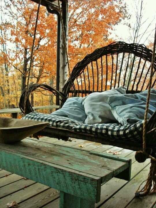 a rustic rattan swing porch will look amazing anytime and in any season