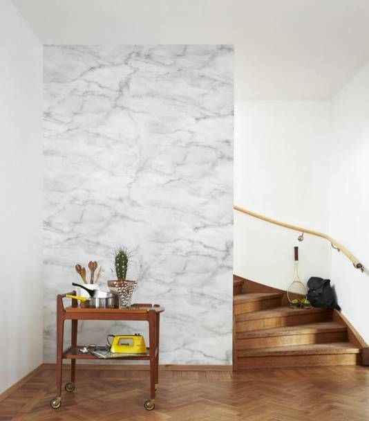cover a wall with marble contact paper and the wole space will get a different look