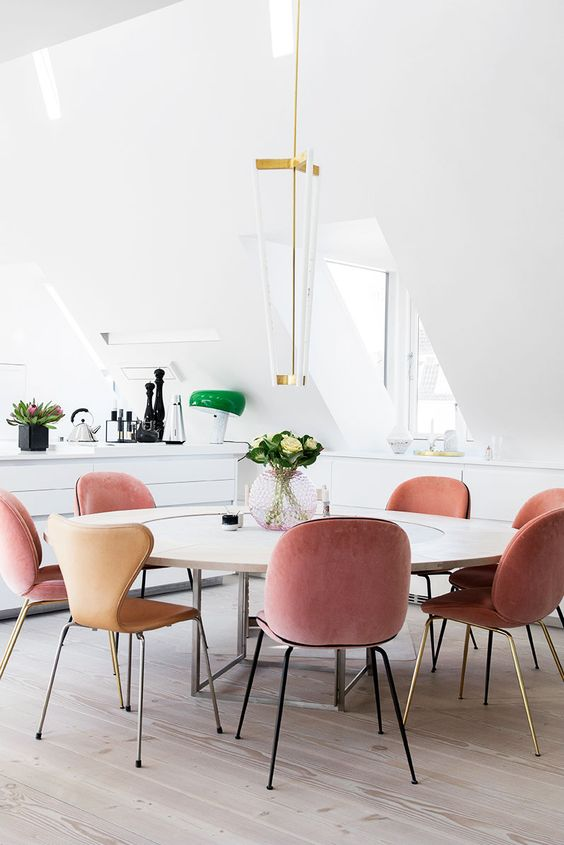peachy pink velvet chairs for a modern and light-filled dining space