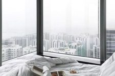 08 two glazed walls and a comfy window sill bed to enjoy the big city views