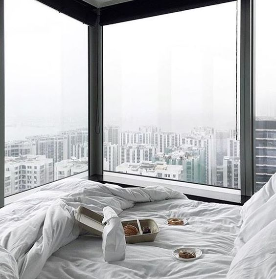 two glazed walls and a comfy window sill bed to enjoy the big city views