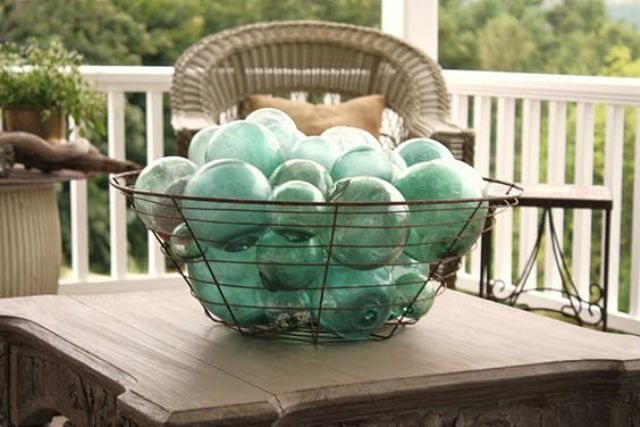 a bowl with glass floats is a simple decoration for indoors and outdoors