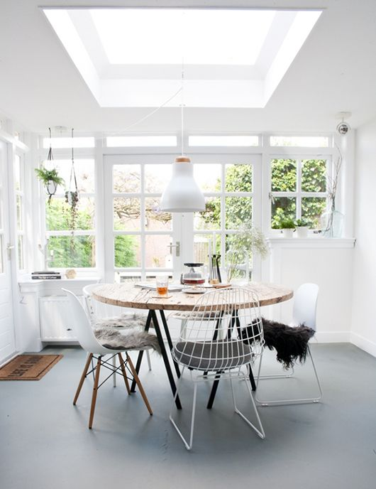 a simple square skylight gives much light to the kitchen and dining room