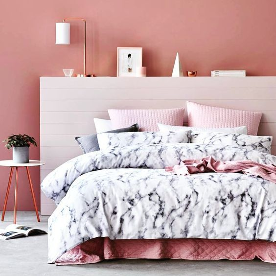 black and white marble bedding with pink parts for a cute feminine sleeping space
