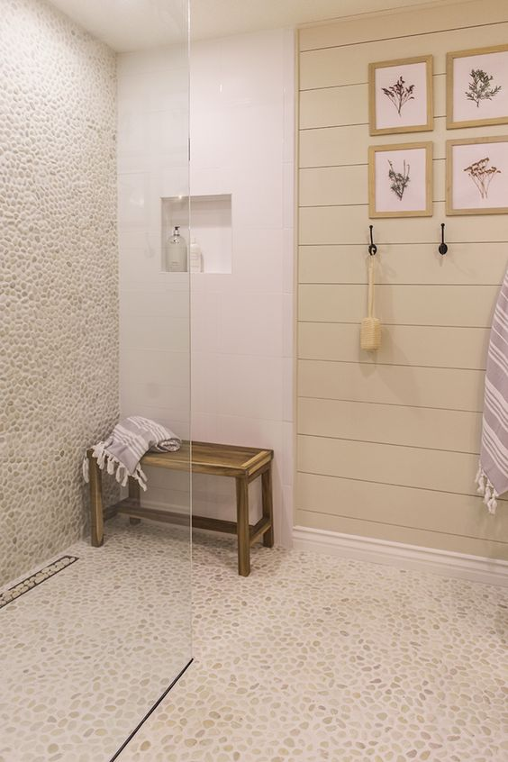cover the shower zone with neutral colored pebble tiles to make it stand out