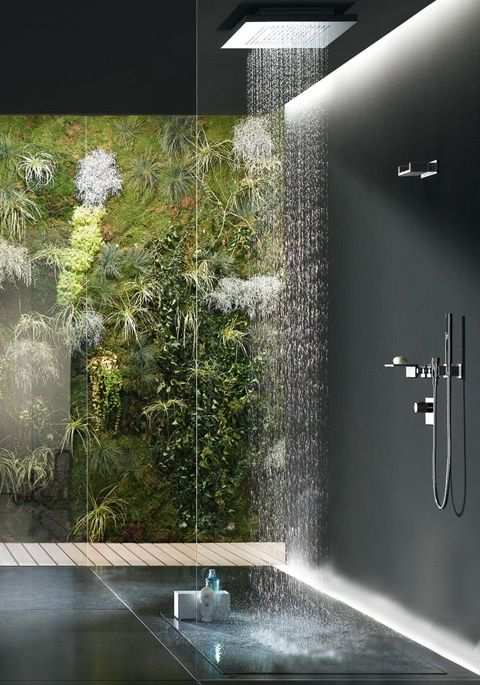 feel having a shower in a waterfall in the jungles with a living wall outside