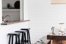 10 a cozy white pass through space with a narrow windowsill and black stools plus a real dining zone